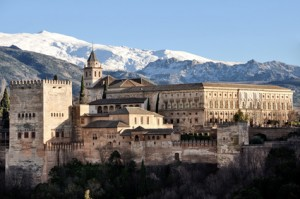 Aerial view of Alhambra Palace in Granada, Spain with Sierra Nevada mountains at the background